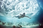 Underwater Photos of People Fighting Waves