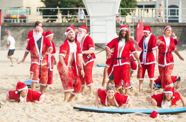 Santas learn to surf at Bondi Beach
